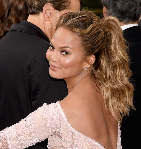 """6 Times Chrissy Teigen Wore A Ponytail And Made """"glam"""" Look Easy Within Messy Waves Ponytail Hairstyles (View 13 of 25)"""