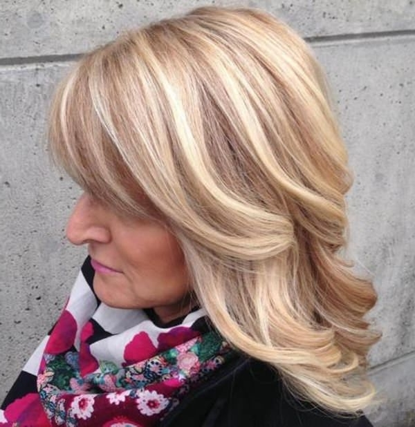 75 Amazing Hairstyles For Any Woman Over 40 – Style Easily With Creamy Blonde Waves With Bangs (View 12 of 25)