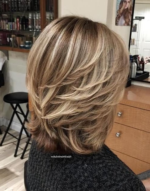 80 Best Modern Haircuts And Hairstyles For Women Over 50 | Hair Throughout Feathered Cut Blonde Hairstyles With Middle Part (View 16 of 25)