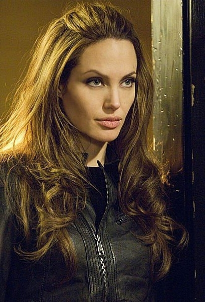 Angelina Jolie's Half Up, Half Down Hairstyle – Prom, Wedding Inside Sleek Half Up Half Down Pony Hairstyles (Gallery 23 of 25)