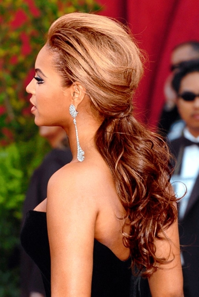 Beyonce's Greatest Hairstyles: 31 Ideas For Curly, Textured Hair Intended For High Ponytail Hairstyles With Long Golden Coils (View 14 of 25)