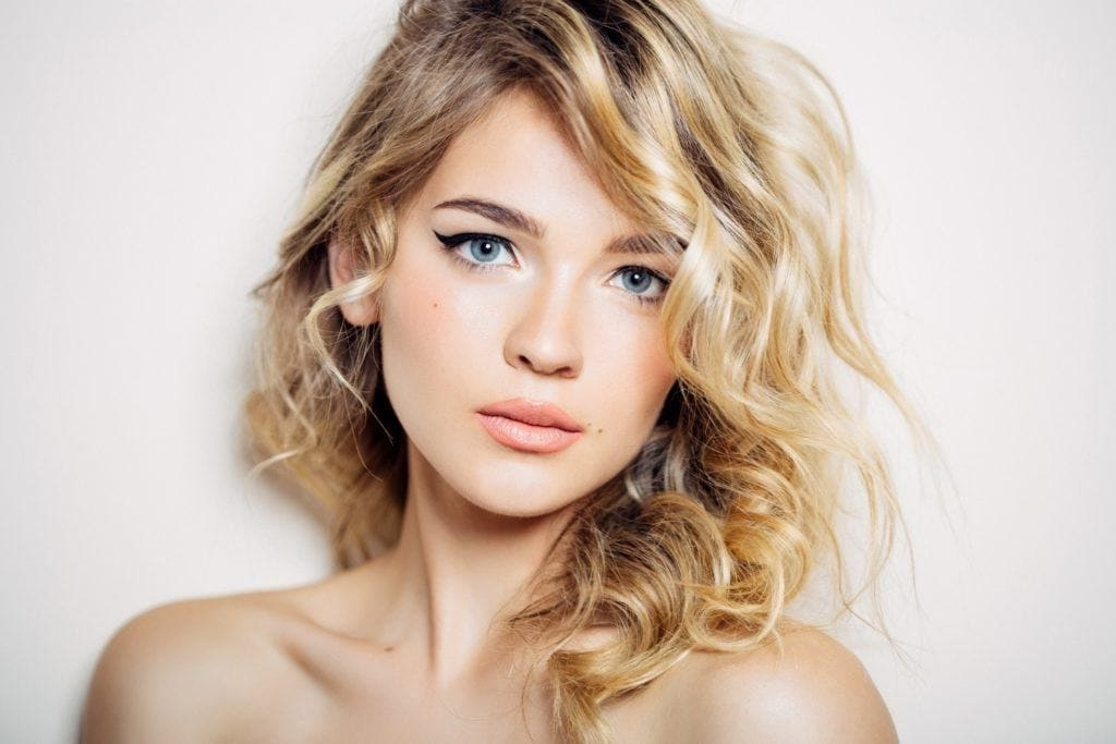 Blonde Curly Hair: 16 Bold And Beautiful Ways To Wear The Look In Warm Blonde Curls Blonde Hairstyles (View 18 of 25)