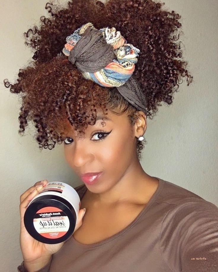 Featured Photo of Natural Curly Pony Hairstyles With Bangs
