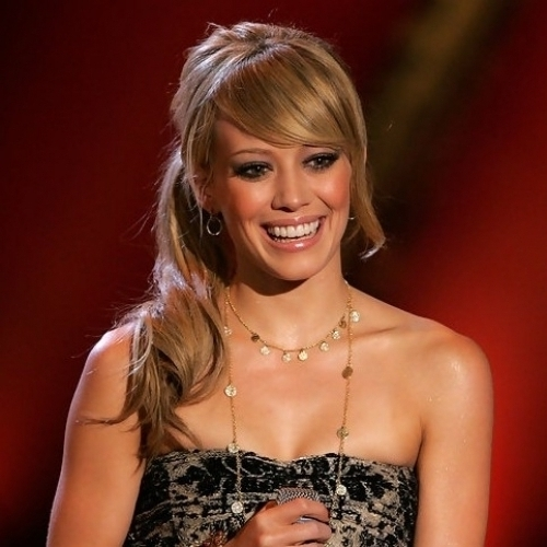 Hilary Duff Low Loose Ponytail With Side Swept Bangs Hairstyles With Regarding Low Loose Pony Hairstyles With Side Bangs (View 24 of 25)