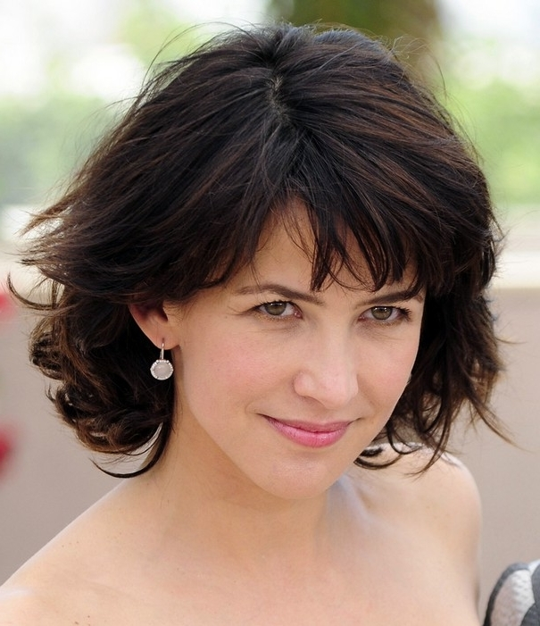 Layered Short Cut For Women Over 40 – Sophie Marceau Hairstyles With Regard To Most Recent Brunette Pixie Hairstyles With Feathered Layers (View 18 of 25)
