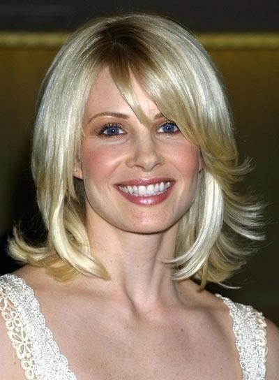 Medium Blonde Hairstyles Potter Medium Length Blonde Shag Hairstyle Within Shaggy Chin Length Blonde Bob Hairstyles (View 13 of 25)