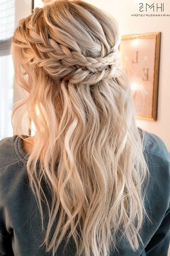 Picture Of A Half Updo With A Double Braid And Beachy Waves Looks Pertaining To Beachy Half Ponytail Hairstyles (View 22 of 25)
