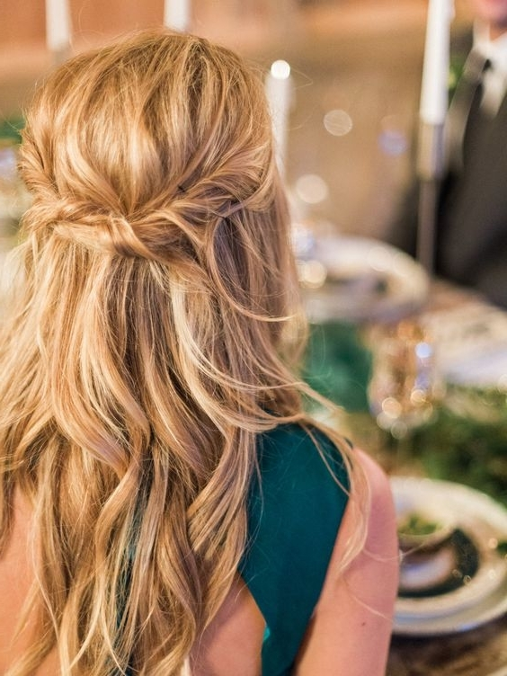Picture Of A Messy Twisted Wavy Half Updo On Long Hair Is A Great Intended For Messy Half Ponytail Hairstyles (View 21 of 25)
