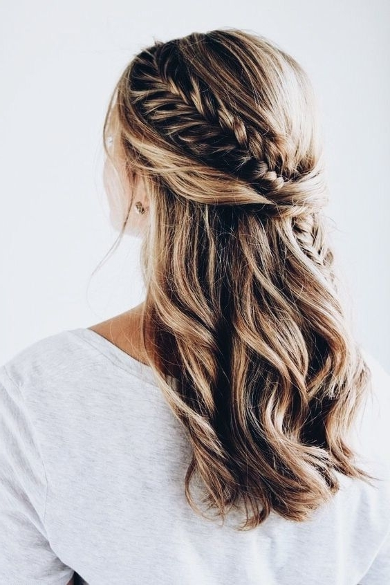 Picture Of A Twisted And Braided Half Updo With Messy Beachy Waves Throughout Beachy Half Ponytail Hairstyles (View 5 of 25)