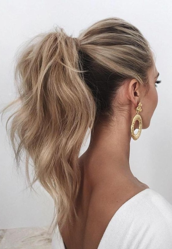 Picture Of A Wavy And Voluminous High Ponytail Looks Chic And In Long Brown Hairstyles With High Ponytail (View 15 of 25)