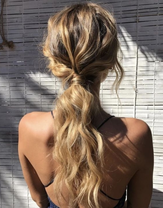 Picture Of A Wavy Messy Low Ponytail With Some Locks Down Is Great With Messy Low Ponytail Hairstyles (View 10 of 25)