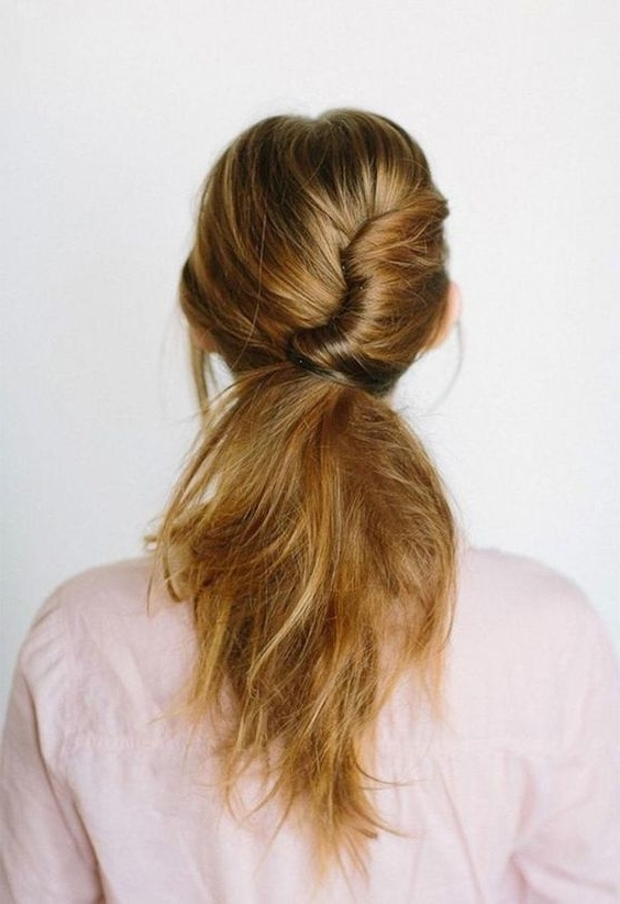 Picture Of Low Messy Ponytail With A Twist Throughout Twisted And Tousled Ponytail Hairstyles (View 12 of 25)