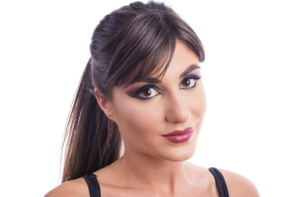 Ponytail With Bangs: 12 Flirty Ways To Wear This Cute Style For Sleek Pony Hairstyles With Thick Side Bangs (View 19 of 25)
