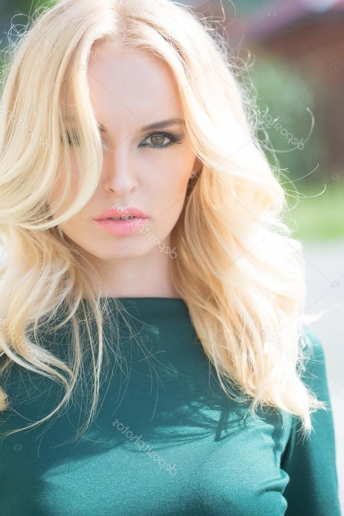 Pretty Blonde Woman In Green Dress — Stock Photo © Tverdohlib Pertaining To Lush And Curly Blonde Hairstyles (View 6 of 25)