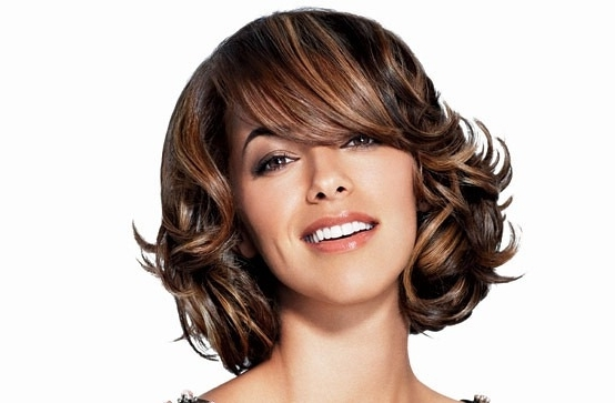 Short Hair Highlights With Caramel Color Inside Most Popular Brunette Pixie Hairstyles With Feathered Layers (View 8 of 25)