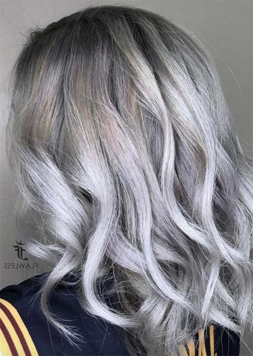 Silver Hair Trend: 51 Cool Grey Hair Colors & Tips For Going Gray Regarding Icy Highlights And Loose Curls Blonde Hairstyles (View 23 of 25)