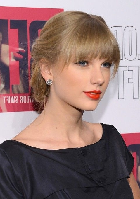 Taylor Swift Braided Updo With Sleek Blunt Bangs | Beautiful With Weaved Polished Pony Hairstyles With Blunt Bangs (View 16 of 25)