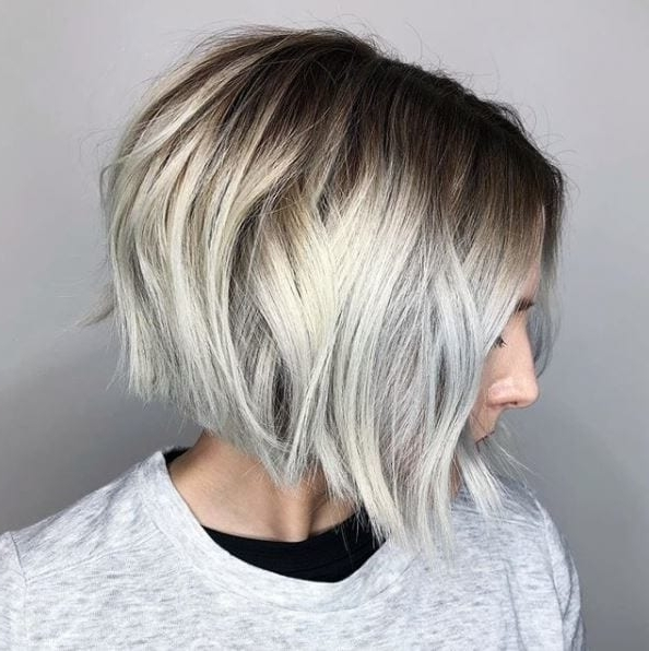 The Angled Bob Haircut That Will Transform Your Everyday Style With Icy Waves And Angled Blonde Hairstyles (View 24 of 25)