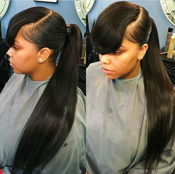 Featured Photo of Low Black Ponytail Hairstyles With Bangs