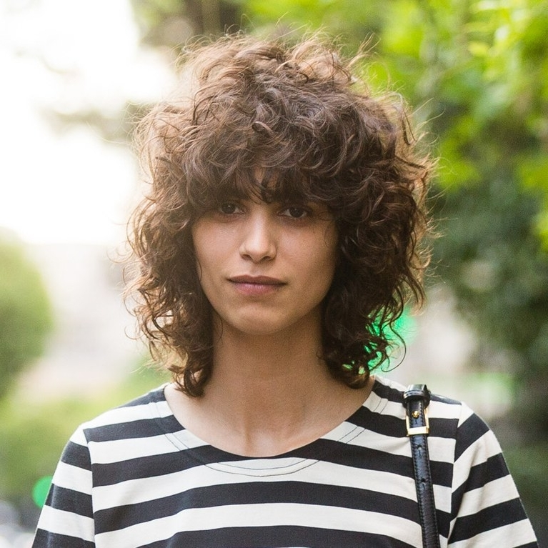 Tips For Great Bangs With Curly Hair | Allure Throughout Natural Curly Pony Hairstyles With Bangs (View 25 of 25)