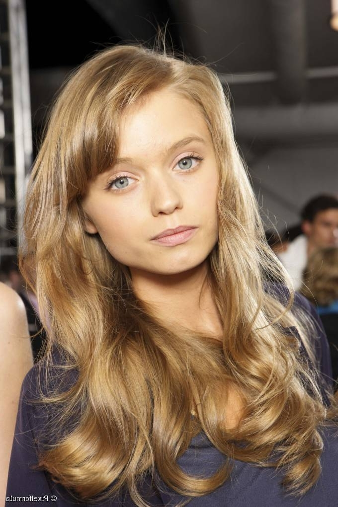 Wavy Hair With Long Side Swept Bangs: Super Subtle Layering With Side Swept Warm Blonde Hairstyles (View 7 of 25)