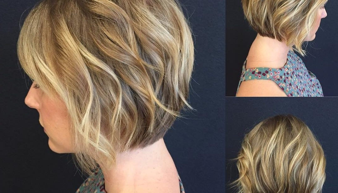 Women's Blonde Stacked Angled Bob With Added Wavy Texture Short Pertaining To Gently Angled Waves Blonde Hairstyles (View 23 of 25)
