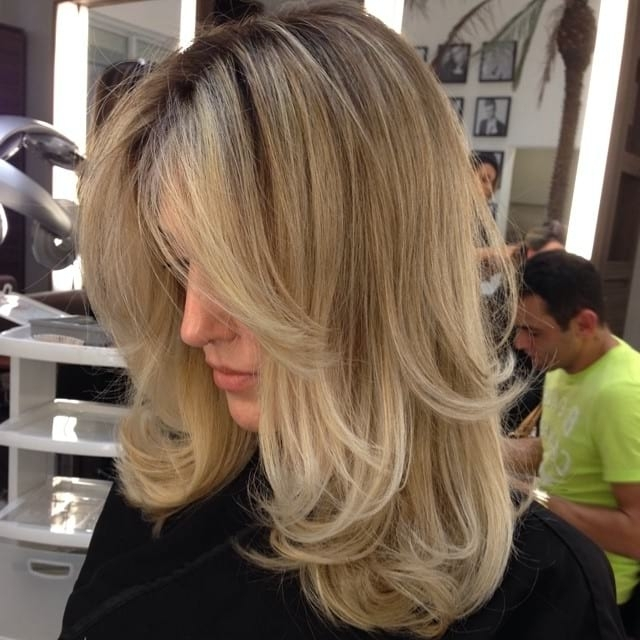 Women's Long Hair With Wispy Long Layers Pertaining To Sun Kissed Blonde Hairstyles With Sweeping Layers (View 13 of 25)
