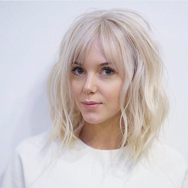 Women's Long Platinum Bob With Wavy Fringe And Parted Bangs Inside Textured Platinum Blonde Bob Hairstyles (View 10 of 25)