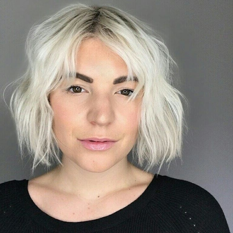 Women's Messy Platinum Textured Bob With Parted Bangs And Shadow Throughout Textured Platinum Blonde Bob Hairstyles (View 16 of 25)