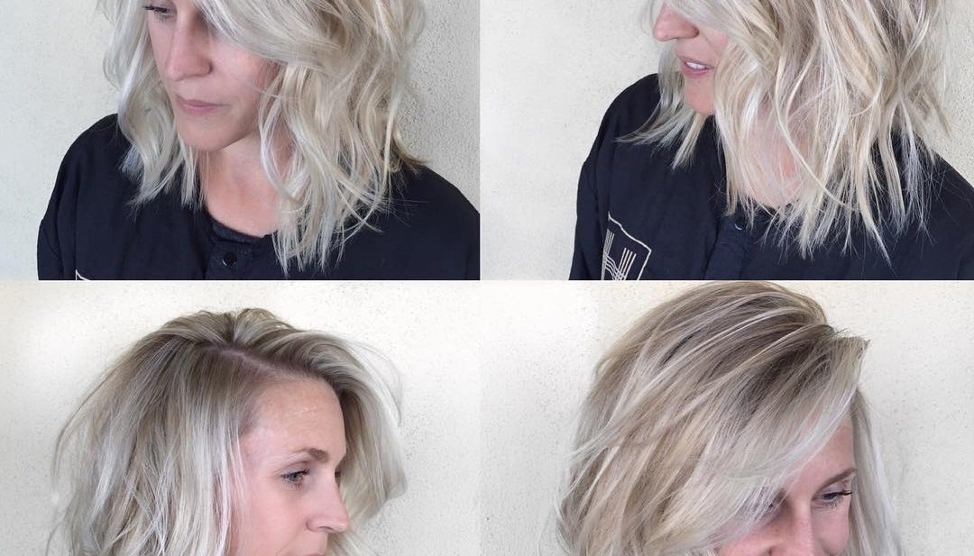 Women's Undone Textured Lob With Long Side Swept Bangs And Pale With Pale Blonde Balayage Hairstyles (View 15 of 25)