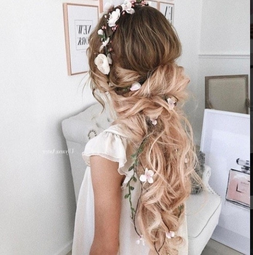 17 Fascinating Flower Girl Hairstyles That You Won't Want To Miss With Wavy Ponytails With Flower (View 1 of 25)