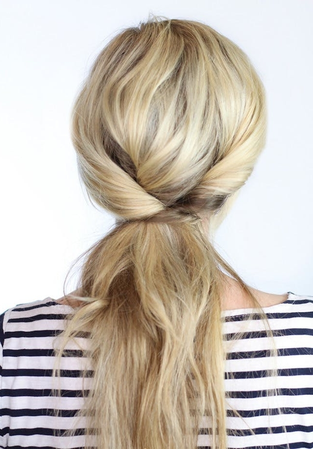 29 Ponytails That Are Anything But Boring | Brit + Co Throughout Tangled And Twisted Ponytail Hairstyles (View 14 of 25)
