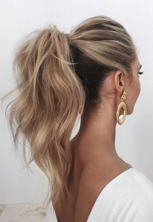 A Wavy And Voluminous High Ponytail Looks Chic And Feminine, Besides Throughout Wavy Free Flowing Messy Ponytail Hairstyles (Gallery 8 of 25)