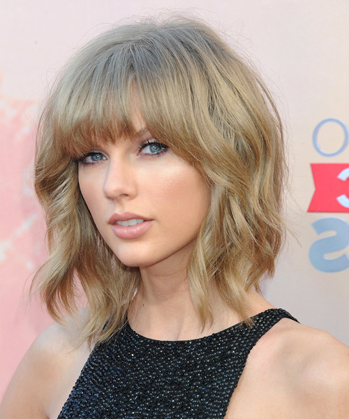 Best Taylor Swift Hairstyles Gallery Inside Caramel Blonde Rounded Layered Bob Hairstyles (View 25 of 25)