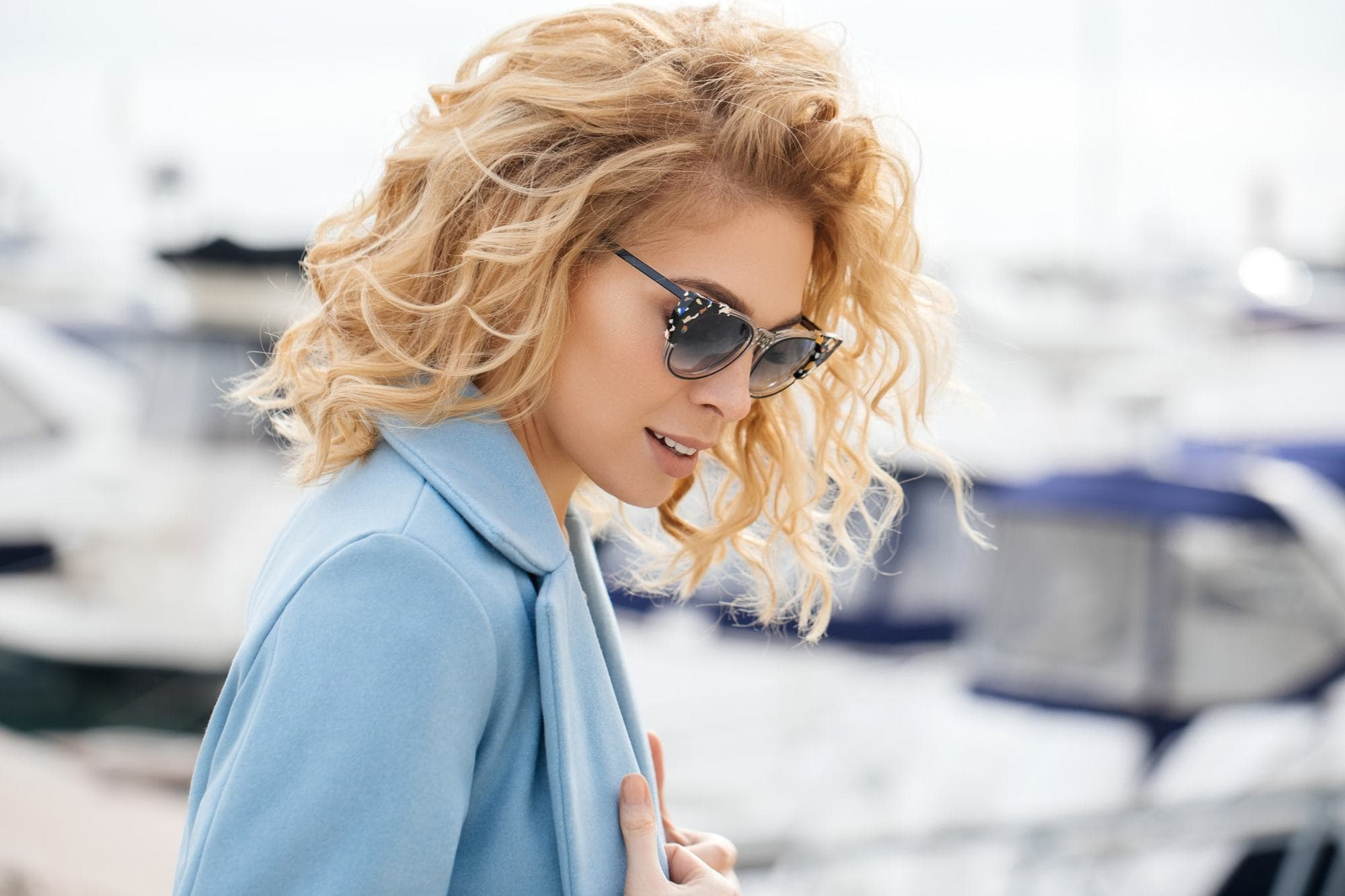 Bold And Beautiful: 16 Ways To Wear Blonde Curly Hair With Regard To White Blonde Curly Layered Bob Hairstyles (View 18 of 25)