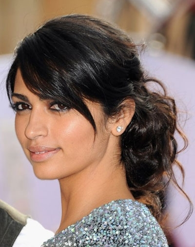 Camila Alves' Disheveled Curly Bun With Low Side Bangs – Prom Within Wavy Ponytails With Side Bangs (View 12 of 25)