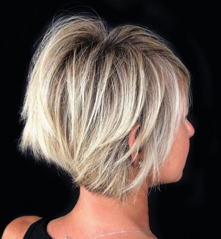Choppy Stacked Blonde Balayage Bob Intended For Dynamic Tousled Blonde Bob Hairstyles With Dark Underlayer (View 16 of 25)