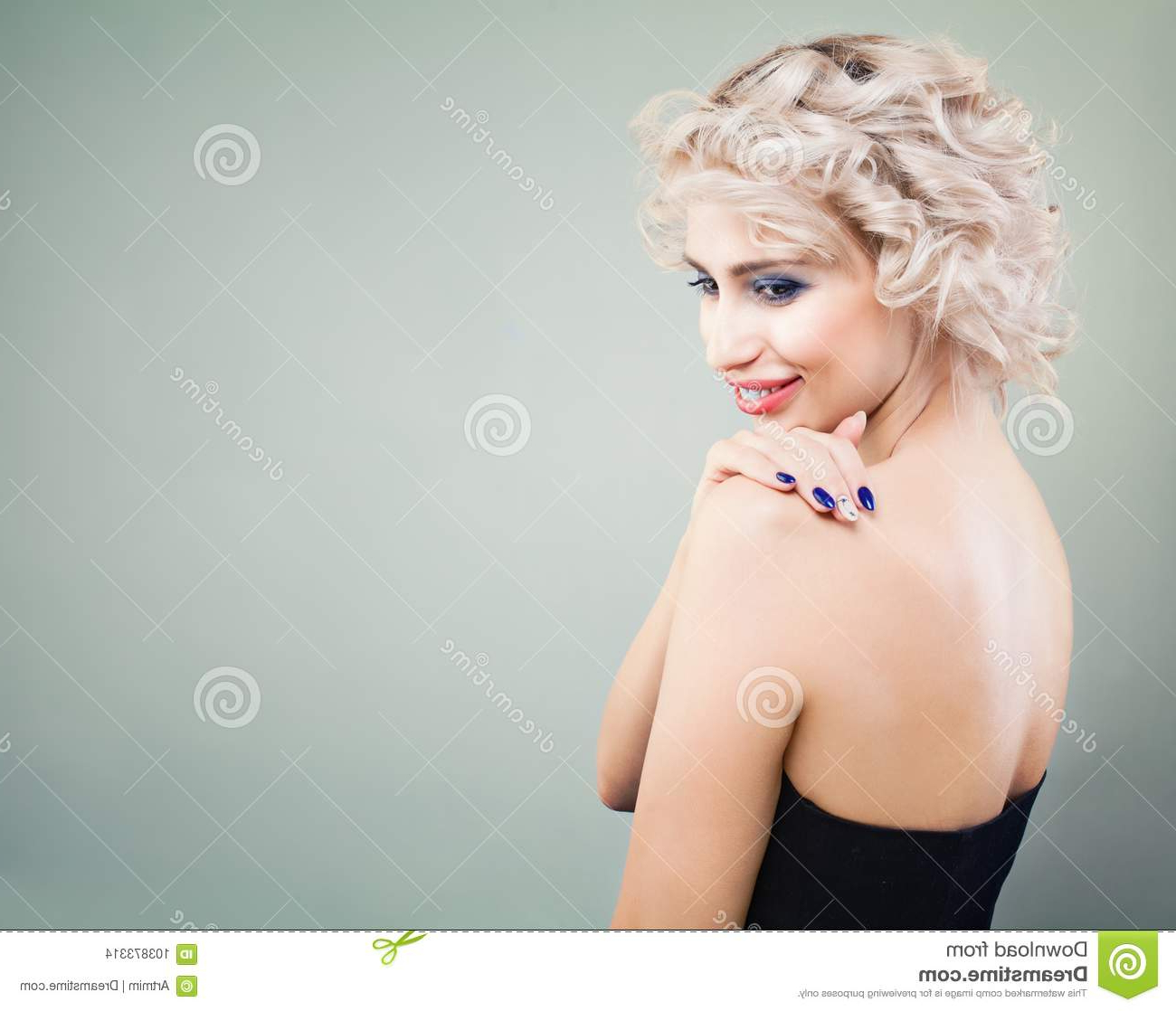 Cute Blonde Woman With Curly Bob Hairstyle And Makeup Stock Photo In Cute Curly Bob Hairstyles (View 25 of 25)