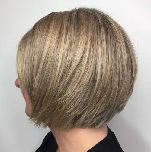 Modern Layered Bob Styles That Are Not Only Beautiful But Low Throughout Angled Bob Hairstyles For Thick Tresses (View 22 of 25)