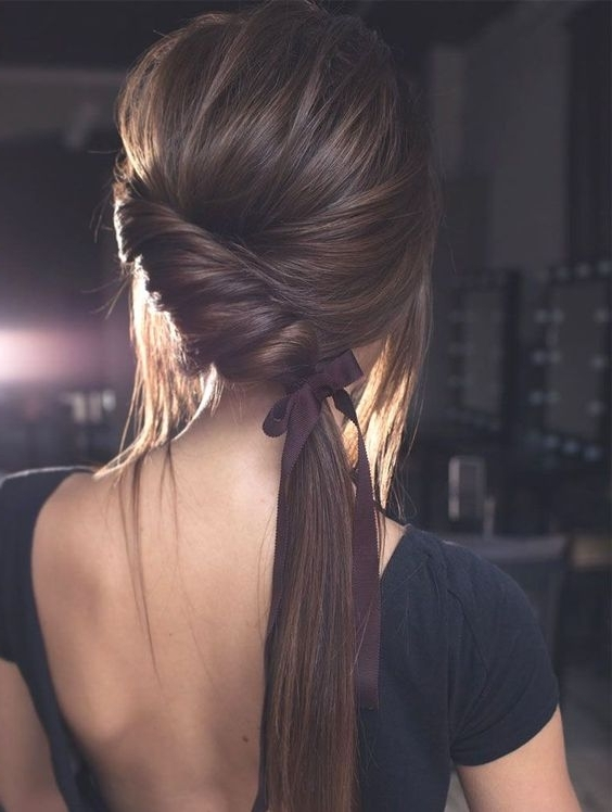Picture Of A Creative Twisted Side Ponytail With A Volume On Top For Creative Side Ponytail Hairstyles (View 15 of 25)