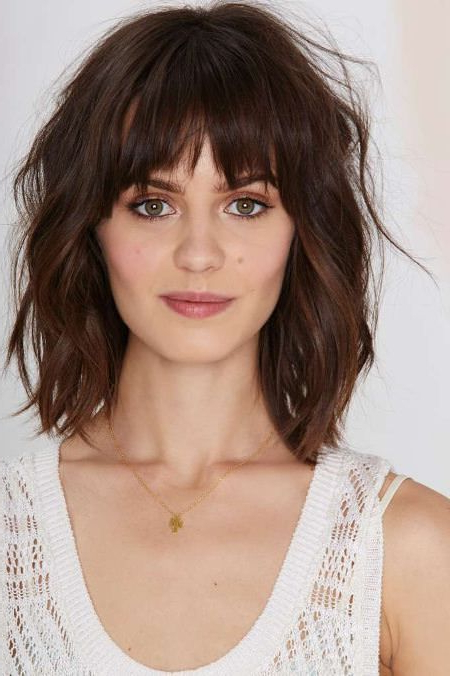 Two Tired Fringes And Tousled Layers Layered Haircut With Bangs Inside Lip Length Tousled Brunette Bob Hairstyles (View 4 of 25)