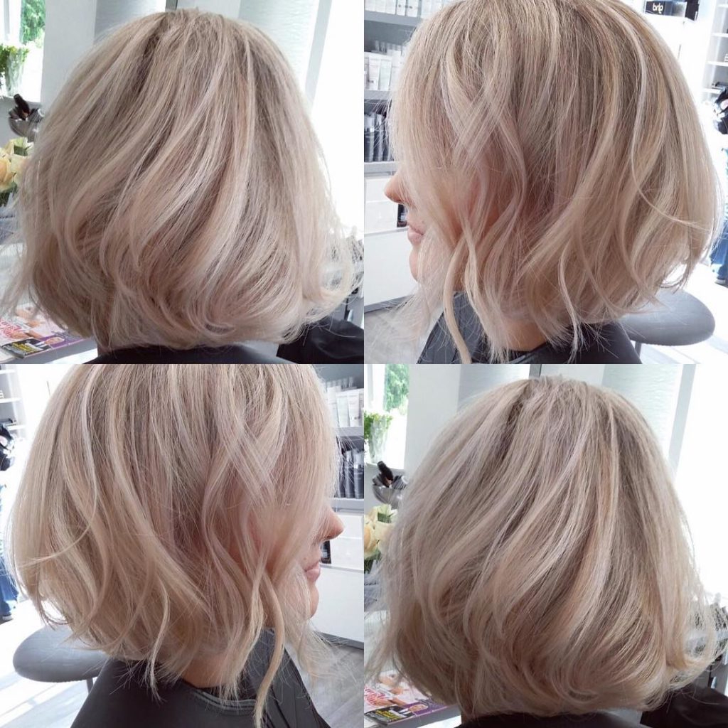 Women's Blowout Angled Bob With Tousled Waves On Blonde Hair With Pertaining To Tousled Wavy Blonde Bob Hairstyles (View 10 of 25)