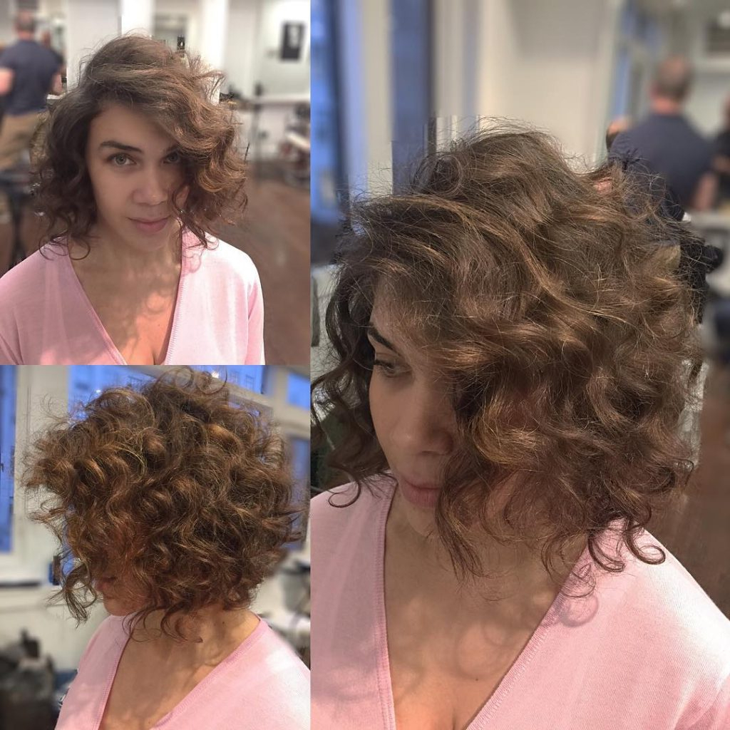 Women's Brunette Angled Bob With Large Soft Curls And Side Part Inside Angled Brunette Bob Hairstyles With Messy Curls (View 6 of 25)