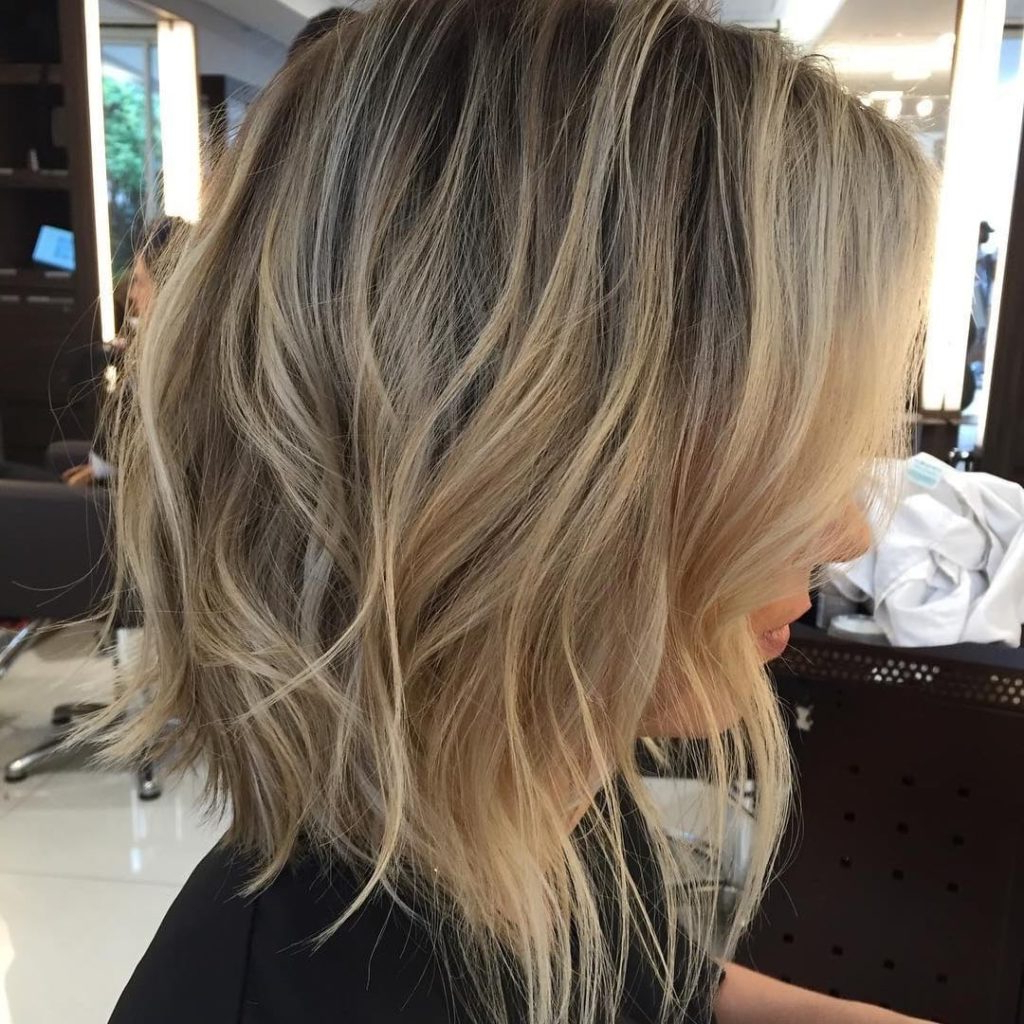 Women's Long Shaggy Angled Bob With Tousled Waves Intended For Tousled Wavy Blonde Bob Hairstyles (View 16 of 25)