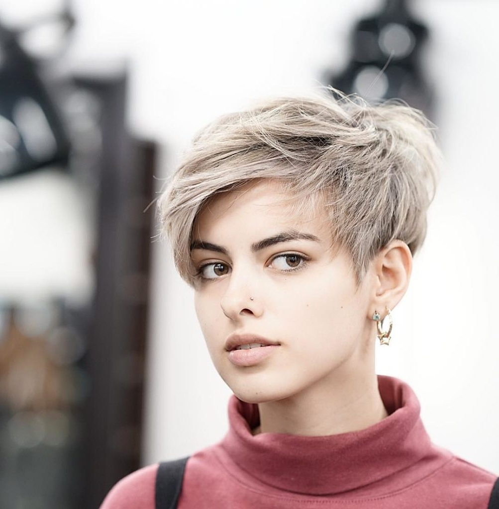 Women's Messy Feathered Pixie With Side Swept Bangs In Short Hairstyles With Feathered Sides (View 7 of 25)