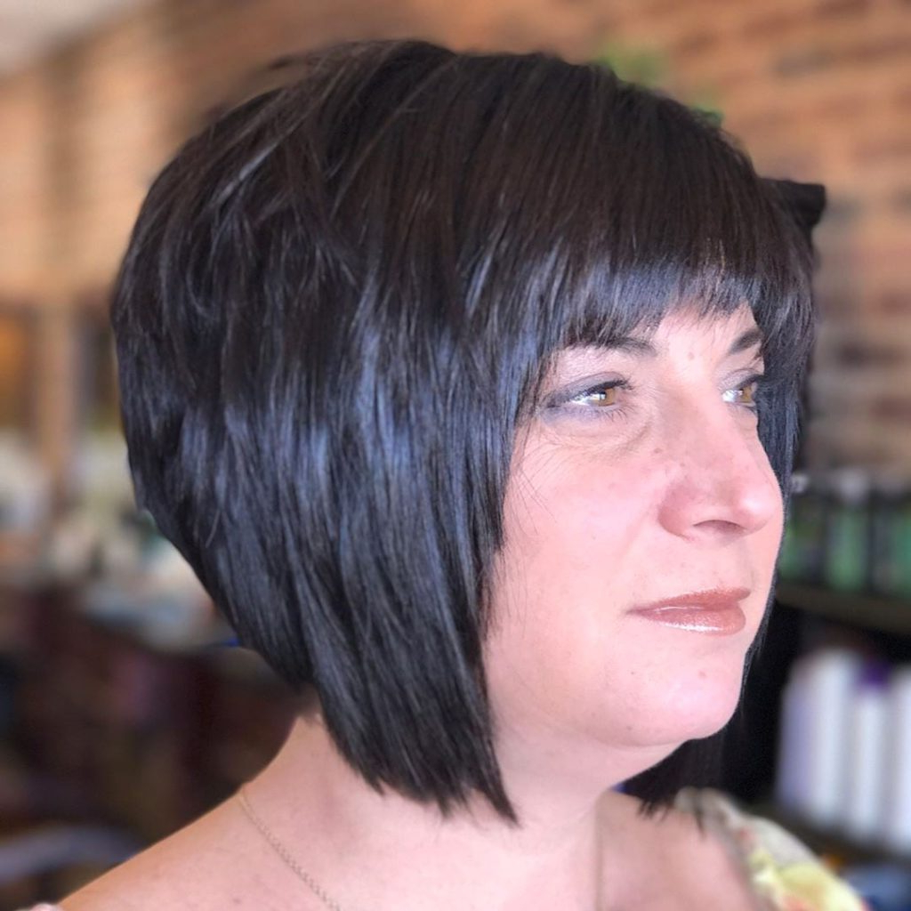 Women's Short Black Angled Bob With Choppy Layers And Choppy Brow For Short Bob Hairstyles With Long Edgy Layers (View 25 of 25)