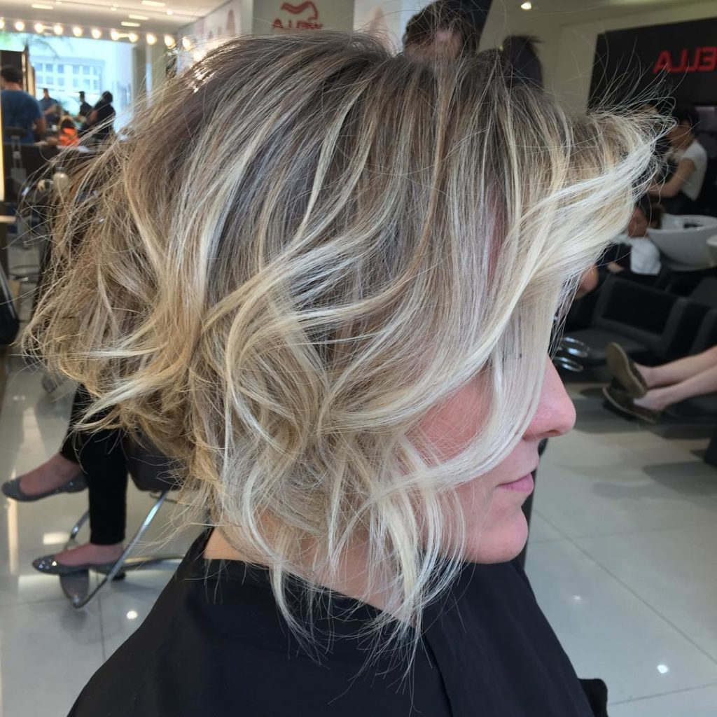 Women's Short Stacked Bob With Messy Voluminous Waves And Balayage Regarding Angled Brunette Bob Hairstyles With Messy Curls (View 14 of 25)