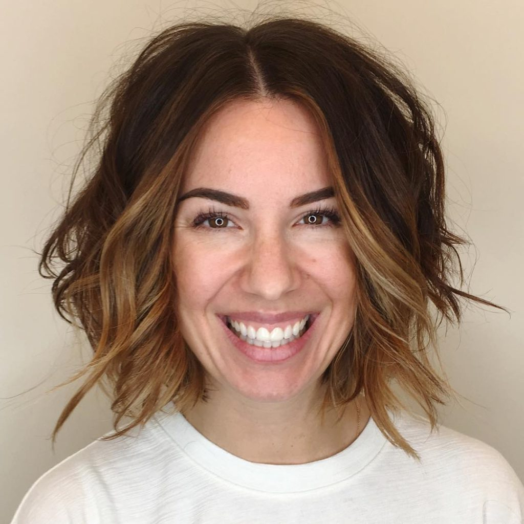 Women's Slightly Angled Soft Layer Bob With Undone Wavy Texture And Throughout Face Framing Short Hairstyles (View 6 of 25)