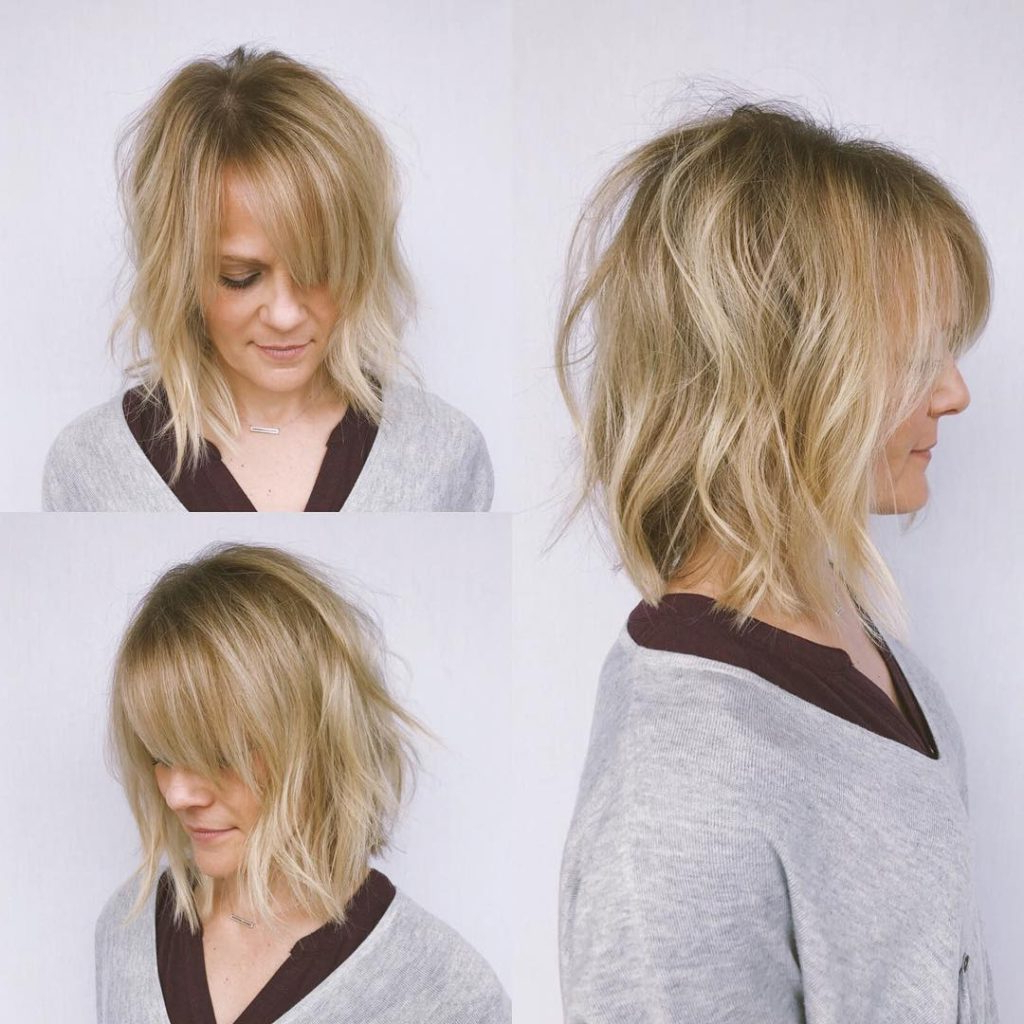 Women's Undone Wavy Textured Bob With Parted Side Swept Bangs And Intended For Side Parted Messy Bob Hairstyles For Wavy Hair (View 23 of 25)