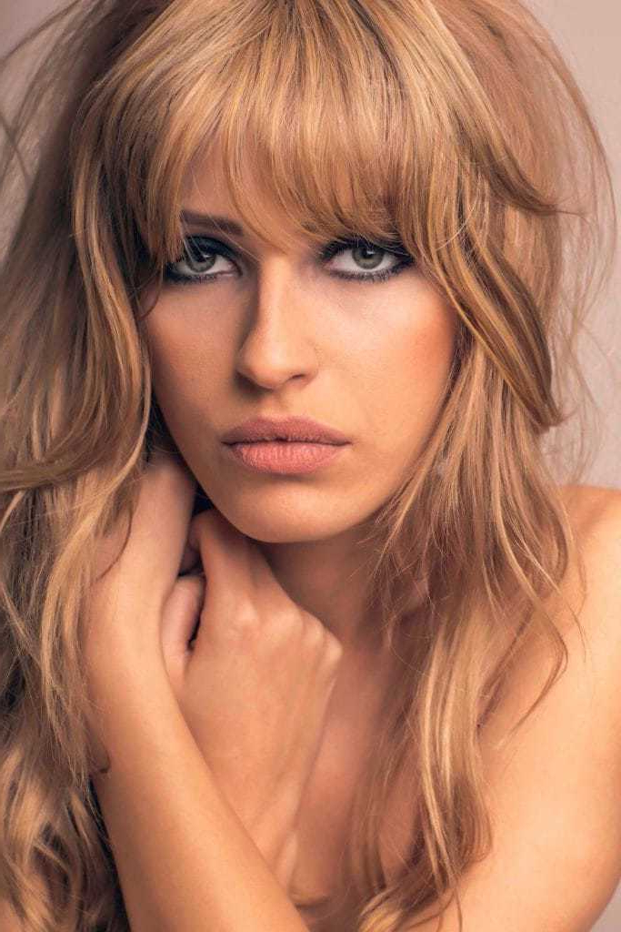 14 Head Turning Hairstyles & Haircuts For Thick Wavy Hair For Most Current Voluminous Wavy Layered Hairstyles With Bangs (View 10 of 25)